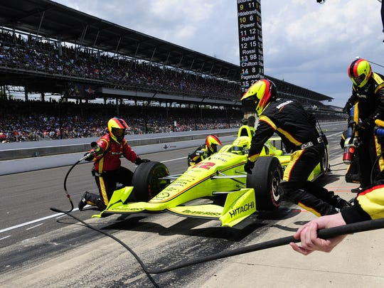 IndyCar driver Simon Pagenaud (22) pits on lap 171during the 100th running of the Indianapolis 500, Sunday at the Indianapolis Motor Speedway.