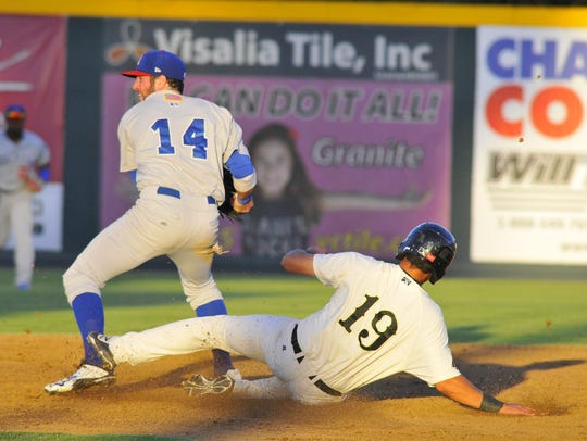 Visalia Rawhide's Joe Munoz, 19, slides into second