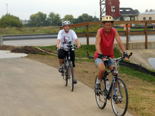 Kelly Cleven (left) and her father Bruno Reynolds on Tracy Trail in Greenwood.