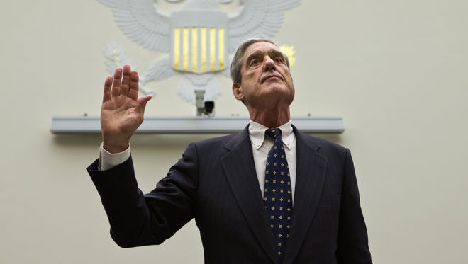 Mueller is sworn in on Capitol Hill on June 13, 2013, prior to testifying before the House Judiciary Committee.