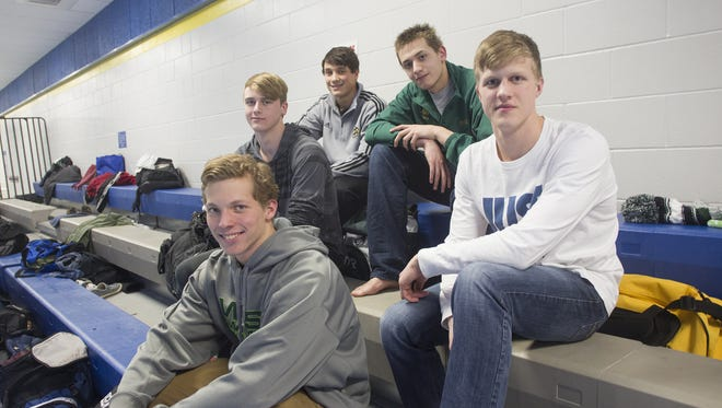 West High swimmers Matt Anderson, from left, Mark McGlaughlin, Oliver Martin, Will Scott and Aidan Keen pose for a photo before practice on Wednesday, Jan. 14, 2015.    David Scrivner / Iowa City Press-Citizen