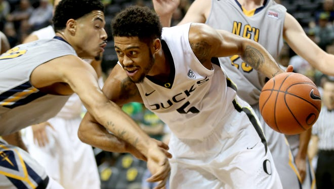 Oregon's Tyler Dorsey (5) drives past Northwest Christian's Omar Richards (22) in the Northwest Christian vs. Oregon men's exhibition basketball game at the Matthew Knight Arena in Eugene on Tuesday, Nov. 3, 2015.