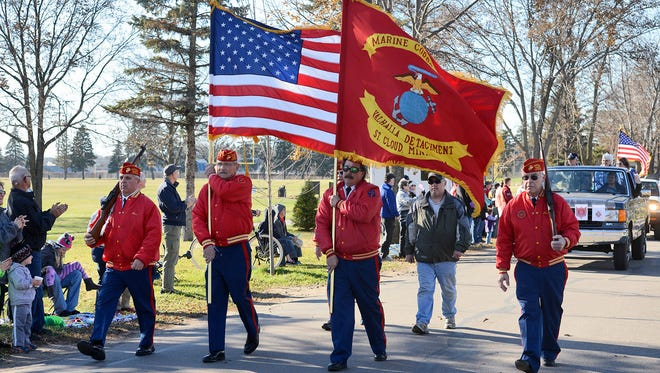 The Valhalla Detachment of the Marine Corps League, St. Cloud, marches in Sunday's parade at the St. Cloud VA Health System grounds.