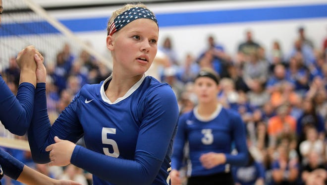 West Liberty's Macy Akers subs out during the Comets' game against West Branch in West Liberty on Tuesday, Oct. 6, 2015.
