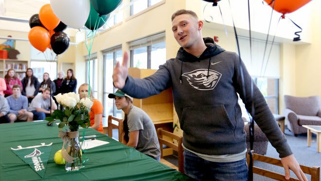 Andy Armstrong speaks after signing a letter of intent to play baseball for Oregon State University during a signing day ceremony at West Salem High School on Thursday, Nov. 12, 2015.