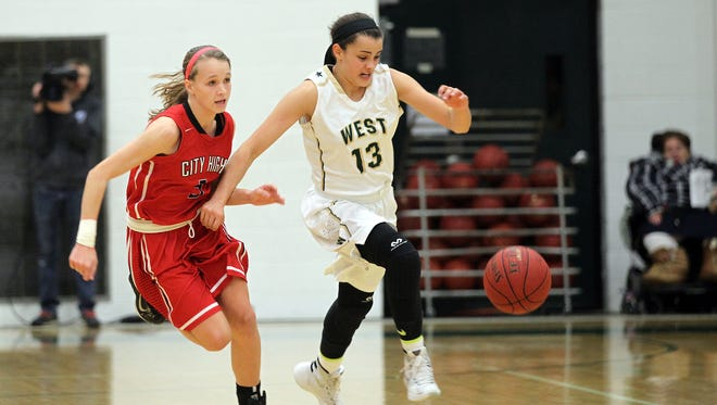 West High's Rachael Saunders, right, and City High's Sydney Schroder chase down the ball during their game at West High on Friday, Jan. 8, 2016.