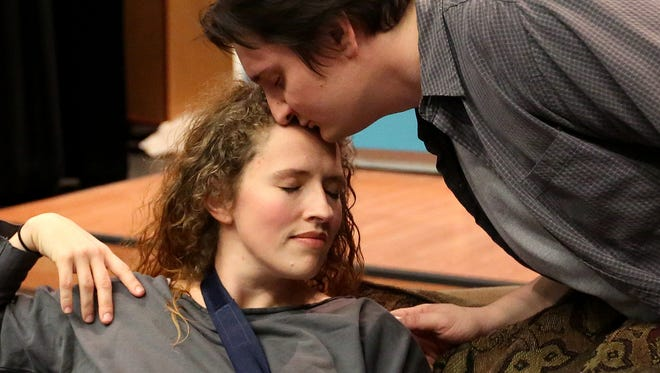 """Christa Karschnia, as Sarah, and Paul Malone, as James, perform during a rehearsal for Keizer Homegrown Theatre's """"Time Stands Still"""" at Chemeketa Community College in Salem. The play will run March 3-12."""