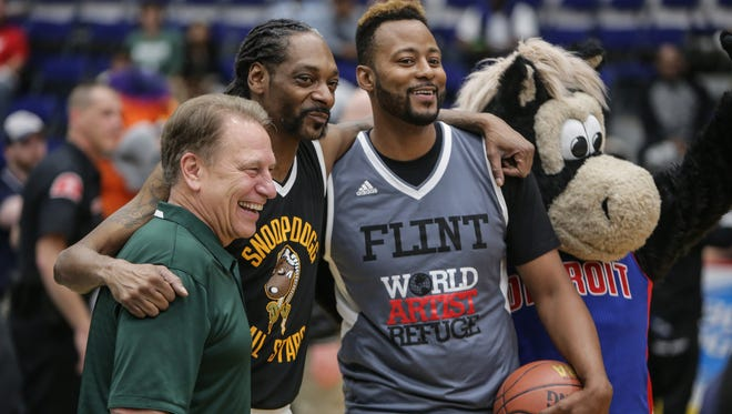 Snoop Dogg poses with Michigan State Basketball head coach Tom Izzo, former Toronto Raptor player Morris Peterson and and Pistons mascot Hooper during the Hoop 4 Water celebrity basketball game at the Dort Federal Event Center in Flint on Saturday May 21, 2016. Proceeds from the event will go toward the Morris Peterson Jr. Foundation for water relief efforts.