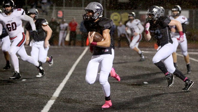 West Salem's Tyler Ballenger (4) rushes for a touchdown in the second half of the McMinnville vs. West Salem football game at West Salem High School on Thursday, Oct. 13, 2016. West Salem won the game 16-8.
