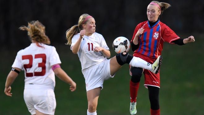 Claire Van der Heide of Benilde-St. Margaret's and Sydney Swanson of Apollo struggle for control of the ball during the first half of the Thursday, Oct. 27, game at Husky Stadium in St. Cloud.