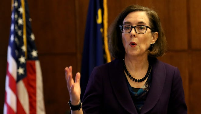Gov. Kate Brown speaks about her proposed 2017-2019 budget at the Oregon State Capitol in Salem on Thursday, Dec. 1, 2016.