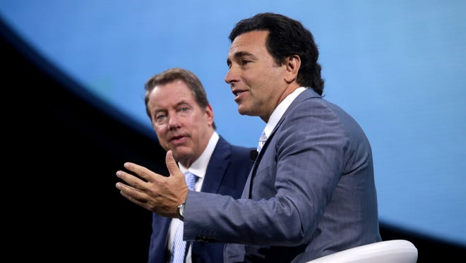 Ford CEO Mark Fields (right) and Ford Executive Chairman Bill Ford speak during the Ford unveiling for the 2017 North American International Auto Show held at the Joe Louis Arena in Detroit on Monday, Jan. 9, 2017.