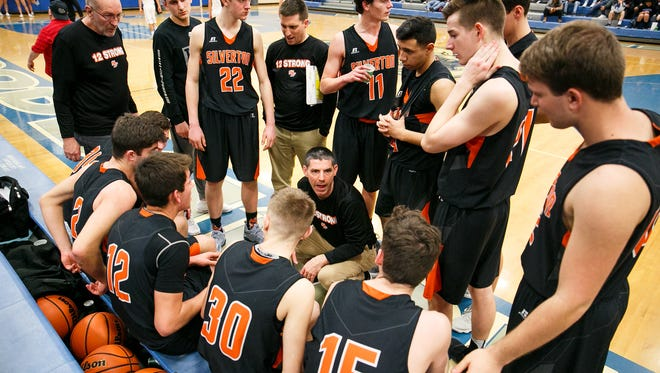 Silverton head coach Jamie McCarty talks to the team during a time out in a basketball game against Woodburn on Tuesday, Feb. 13, 2018, at Woodburn High School. McCarty was the boys basketball coach at Stayton High School for nine years, leading the Eagles to a 4A state championship in 2007. This is his first head coaching job since the 2006-2007 season at Stayton.