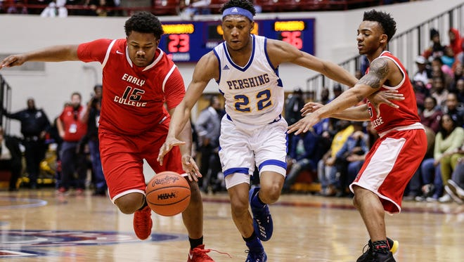 Pershing guard DÕJuan Seal (22) tries to dribble past Edison forward Keith Johnson (15) and guard Dominyck Thomas (5) during the first half of the Detroit Public School League championship game at University of Detroit Mercy in Detroit, Friday, February 16, 2018.