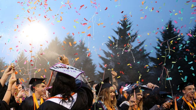 Graduates celebrate with confetti and silly string during the Sprague High School commencement at Sprague High School on Friday, June 8, 2018.
