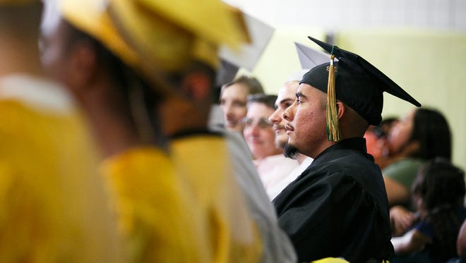 Ezequiel V. watches the graduation ceremony at MacLaren Youth Correctional Facility on Wednesday, June 27, 2018. Ezequiel received his associate's degree from Chemeketa Community College, one of two students at the facility to be awarded a college degree in this ceremony.