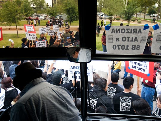 Opponents of SB 1070 arrive by bus from California