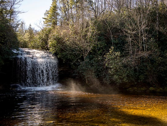 Sunlight streams as water tumbles over Schoolhouse