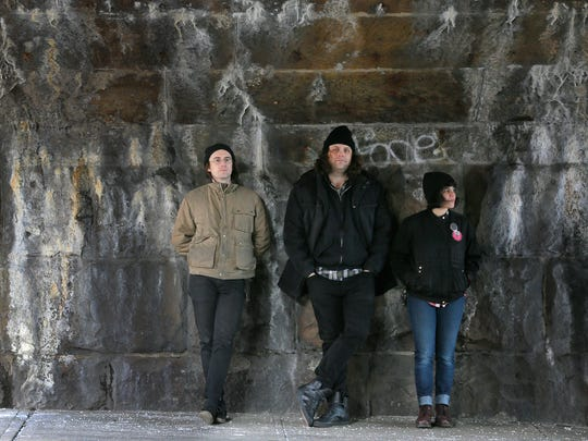 The Screaming Females participate in a photo shoot at the train station in New Brunswick, NJ Friday January 31, 2018. (L-R) Jarrett Dougherty, Michael Abbate and Marissa Paternoster.