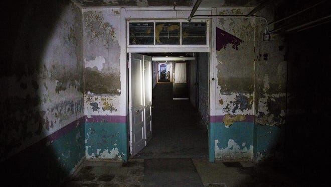 A room in in the Randolph County Infirmary is illuminated by flashlight Saturday.