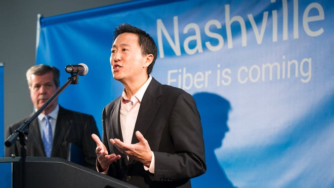 Kevin Lo, the general manager of Google's fiber-optic Internet services, announces during a news conference in Nashville, Tenn., on Tuesday, Jan. 27, 2015, that the city is among four metro areas selected to receive gigabit-speed connections. The other areas are Atlanta and Raleigh-Durham and Charlotte in North Carolina. At speeds of more than 50 times the national broadband average, gigabit service can download an entire movie in less than two minutes.