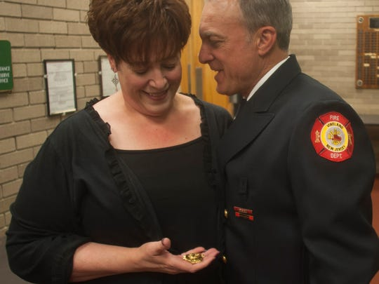 Fire Captain Luigi Tramontana Jr. shares a moment with Denise Ciulla minutes before being sworn in as the new Vineland fire chief. Ciulla's father used to be Tramontana's mentor.