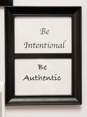 """The framed inspirational words of """"Be Intentional."""