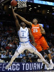 Syracuse guard Tyus Battle (25) tries to block in a shot in last week's ACC Tournament.