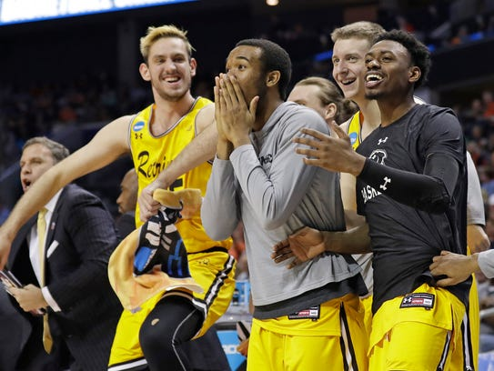 UMBC players celebrate a teammate's basket against