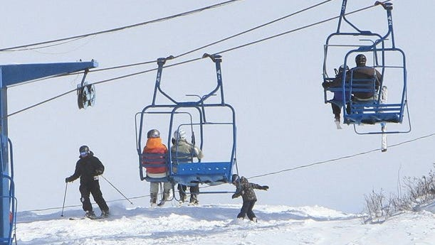 People enjoy the fresh snow as they ski and board at Thunder Ridge ski area in Patterson last year.