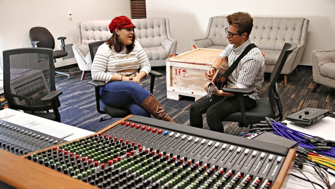 Desiree Aguilar (left) and Tanner Krenz, both sophomores pursuing bachelor of worship arts degrees, work on an original song at the new recording facility at Grand Canyon University in Phoenix on Dec. 2, 2015.