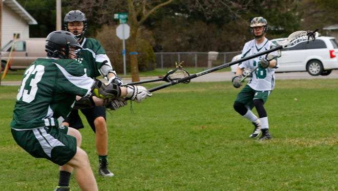 D.C. Everest lacrosse team practices drills Wednesday, April 19, 2017, at Kennedy Park in Weston to prepare for the Feel the Love fundraiser to support the Women's Community.