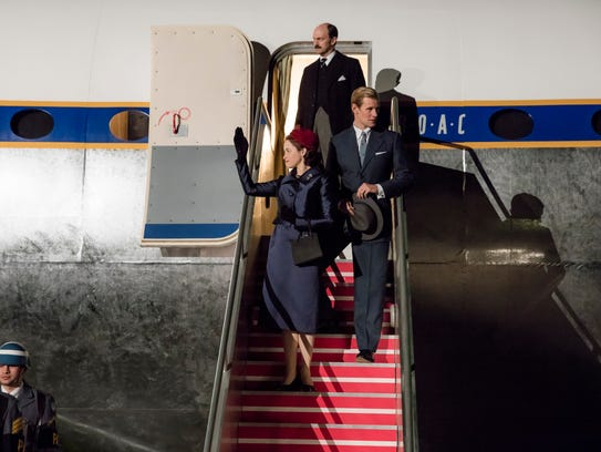 Queen Elizabeth II (Claire Foy), her private secretary Michael Adeane (Will Keen) and husband Philip (Matt Smith) return from a world tour in Season 2 of 'The Crown.'