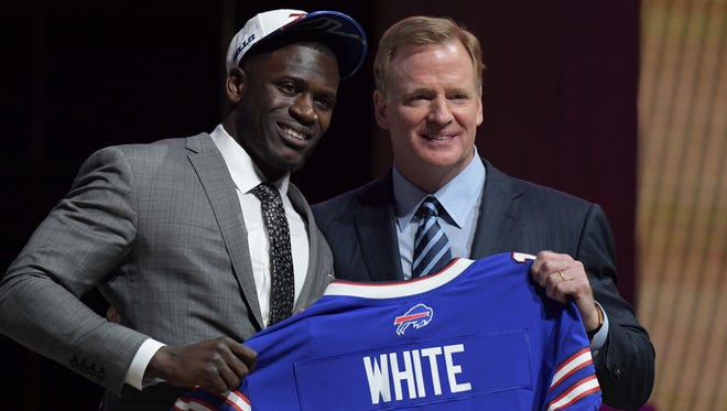 The Bills' first-round pick, Tre'Davious White, after the man hug with NFL commissioner Roger Goodell.