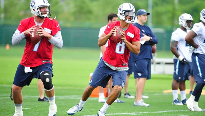 Zach Mettenberger (7) and Marcus Mariota (8) throw passes during Titans practice at Saint Thomas Sports Park on Tuesday.