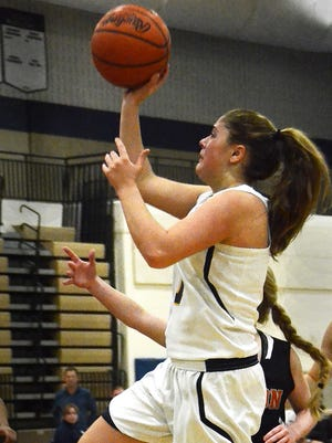 Abby Ratkowiak scored eight first-half points to help Hartland stay close to Fenton before the Eagles took over in the second half.