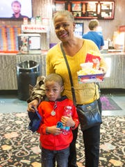 Angela French-Coles and her grandson before their movie at the Village 8.