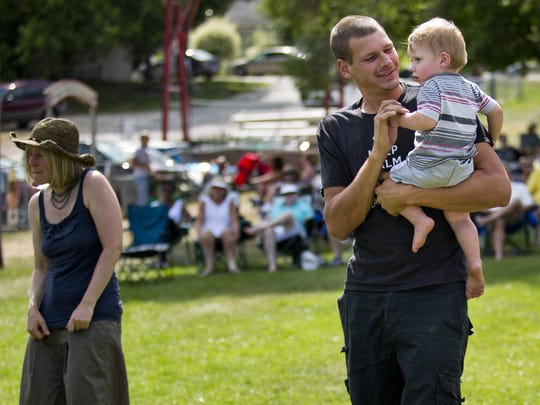 Jacob Pringle, of Croswell, dances with his son Athan Hunt, 15-months, during the East Ports Blues Festival Saturday, Aug. 1, in Port Sanilac.