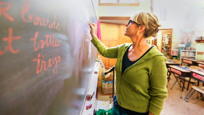 Fourth grade teacher Heather Kono writes on the chalkboard in her classroom at the The Green Meadow Waldorf School in Chestnut Ridge on Tuesday, August 29, 2017.