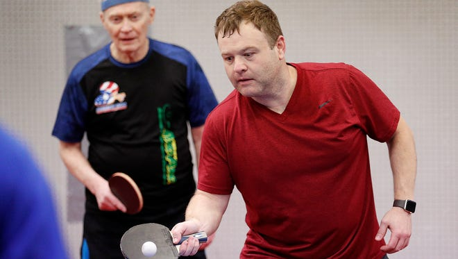 Comedian and impressionist, Frank Caliendo is in Indianapolis this week hosting the Bob and Tom show for a few days. Frank is a table tennis enthusiast and a member of USA Table Tennis. Here he is playing double with Richard Hicks at the Table Tennis Club of Indianapolis on East Washington Street on Wednesday, April 11, 2018.