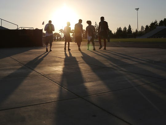 Palm Springs players walk away after taking part in a University of Washington football camp at the University of Redlands .