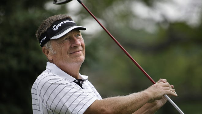 Mark Bemowski watches a tee shot during the 2009 State Amateur Championship at Merrill Hills Golf Course.