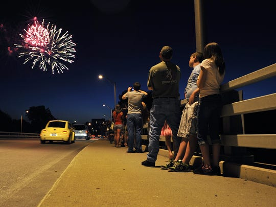 People watch fireworks from the downtown bridges during Lafayette's Stars and Stripes Celebration in 2011.