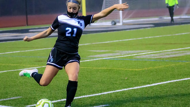 Madison Miller controls the ball and sends it down the field.