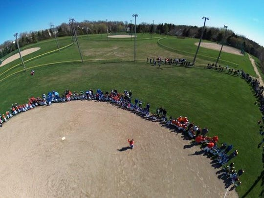 A drone captured this photo, of PCLL players lined up around the edge of the infield of McClumpha Park Field No. 1 during Saturday's Opening Day festivities.