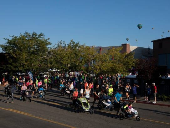 Competitors start the stroller portion of the 49th