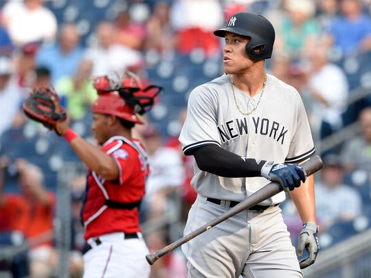New York Yankees' Aaron Judge walks back to the dugout