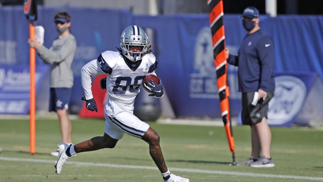 Rookie receiver CeeDee Lamb turns upfield on a play during the Dallas Cowboys' training camp last week. Lamb, the sixth highest rated draft pick on the team's 2020 draft board, fell all the way to No. 17.