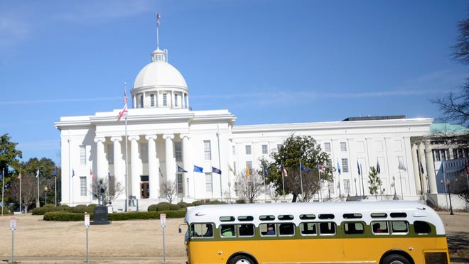 The Rosa Parks Bus sits in front of  the Alabama Department of Archives and History in this file photo.