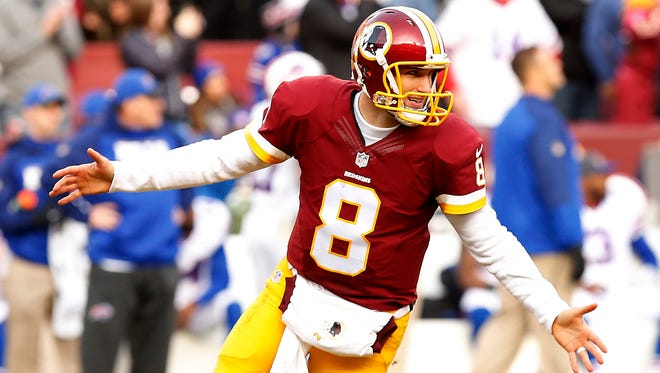 Washington Redskins quarterback Kirk Cousins (8) celebrates after throwing a touchdown pass to Redskins wide receiver DeSean Jackson (not pictured) against the Buffalo Bills in the third  quarter at FedEx Field.